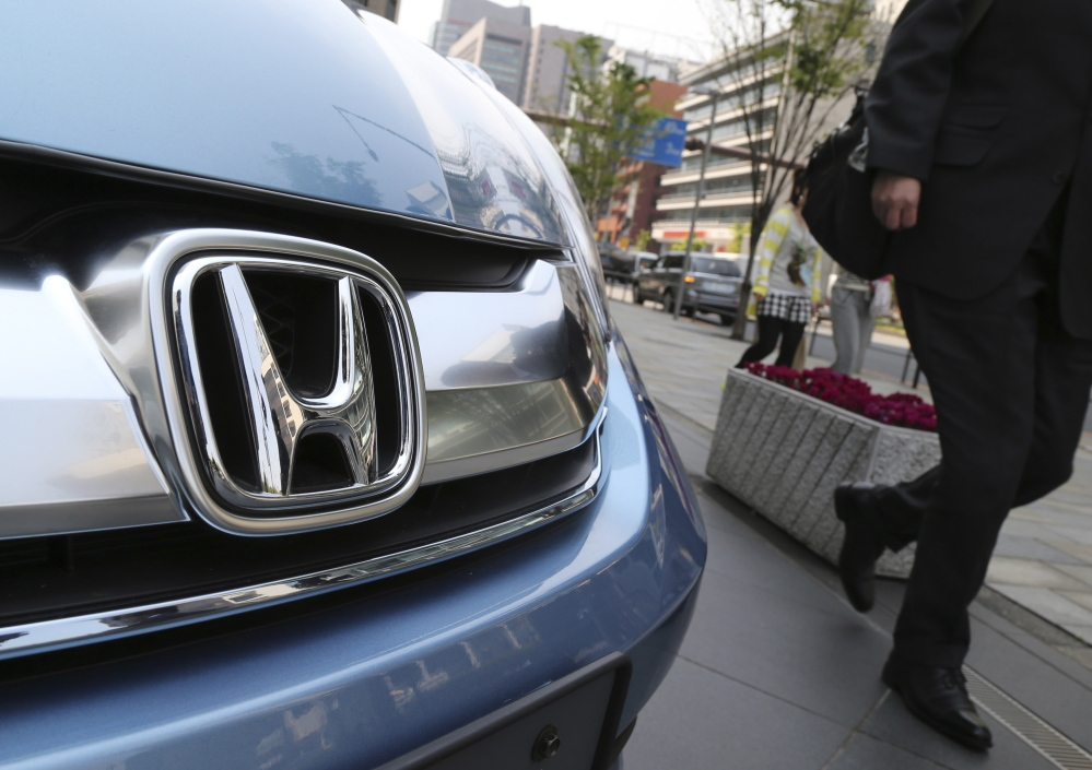 Honda Motor Co. displays a vehicle at its headquarters in Tokyo. U.S. officials say the automaker has agreed to pay a $70 million fine for failure to report violations.  The Associated Press