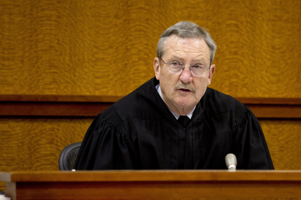Judge E. Paul Eggert heard the case Monday, telling Sineni that as an attorney he should have known better.