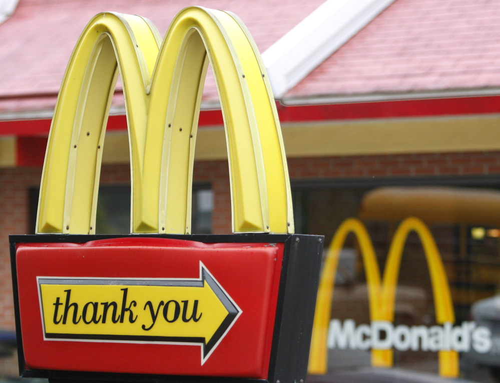 An ad that aired during the NFL playoffs and Golden Globes on Sunday featured signs outside McDonald's restaurants, including messages of support after devastating events. The Associated Press