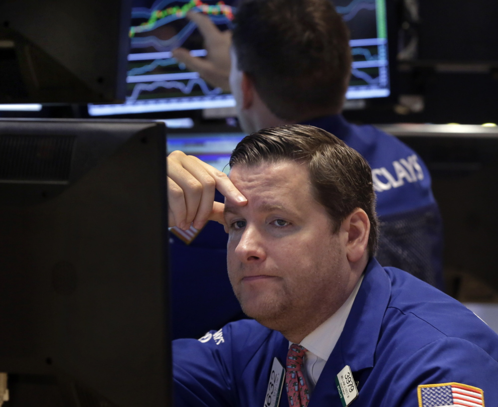 Trader Gregg Maloney works on the floor of the New York Stock Exchange. There was little good news Monday as U.S. crude oil hit $46.07 a barrel, which put a drag on stocks. The Associated Press