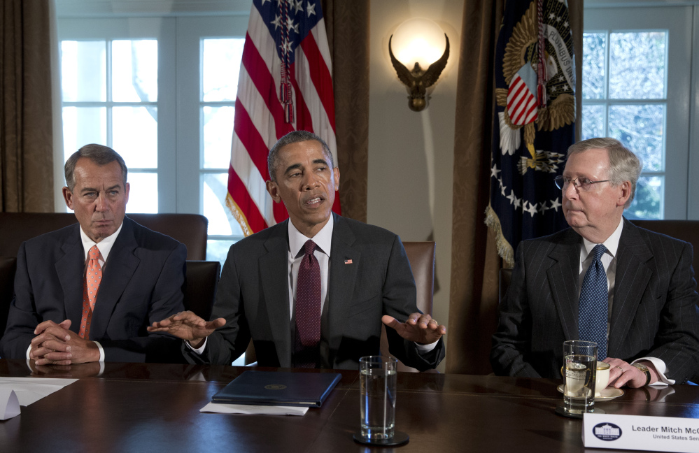 President Obama, flanked by House Speaker John Boehner of Ohio, left, and Senate Majority Leader Mitch McConnell of Ky., speaks to media on Tuesday before his meeting with the bipartisan, bicameral leadership of Congress to discuss wide-ranging issues. The Associated Press