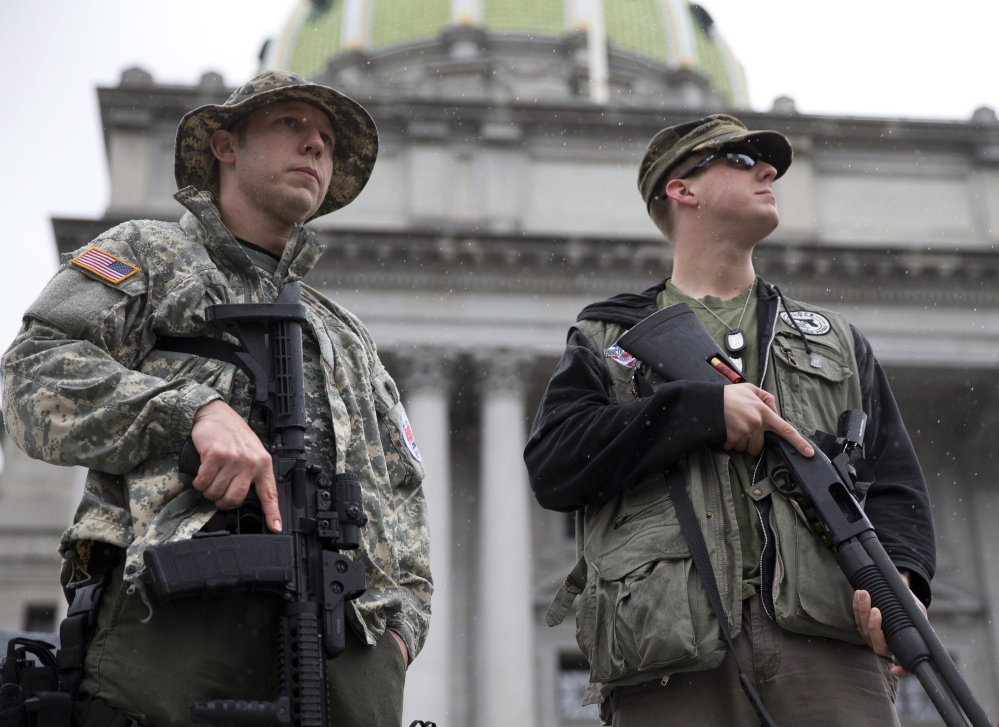 Gun rights advocates demonstrate at the State Capitol in Harrisburg, Pa., on Tuesday during the Second Amendment Action Day. A new state law is taking aim at municipal regulations on guns. The Associated Press