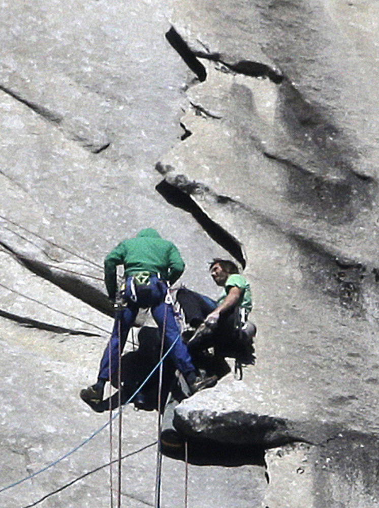 """Tommy Caldwell, left, and Kevin Jorgeson approach the summit of El Capitan on Wednesday. The men started """"free-climbing"""" to the 3,000-foot summit on Dec. 27, using no climbing aids other than ropes to prevent falls. The Associated Press"""