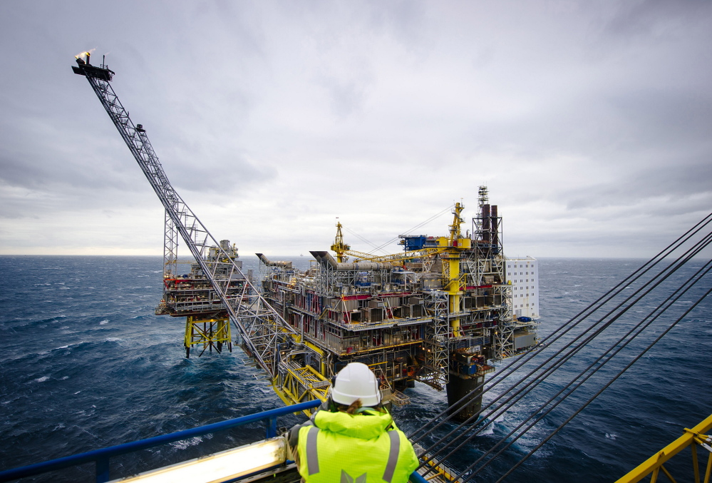 A visitor observes the flare stack on the Oseberg A offshore gas platform operated by Statoil in the North Sea off Bergen, Norway. Crude oil exploration in the Arctic is being curtailed by companies because of the expense and the recent plunge in global prices. Bloomberg News photo by Kristian Helgesen