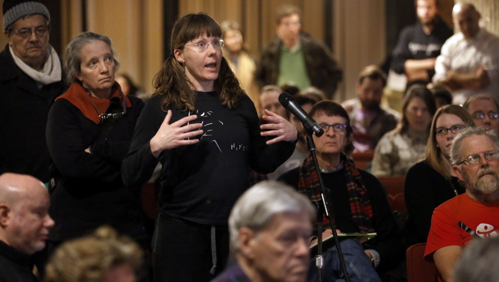 Monica Bowen, of Boston, asks a question during a public meeting Wednesday to mobilize efforts to keep the 2024 Summer Olympic Games from coming to the city.  The Associated Press