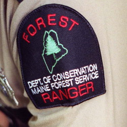 Maine's forest rangers would focus on firefighting, monitoring the health of Maine's forests and working with landowners on pest management under Gov. Paul LePage's proposed budget. 1999 Press Herald File Photo/John Patriquin