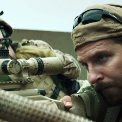 """Bradley Cooper, right, appears in a scene from """"American Sniper."""" The movie has drawn criticism from some as military propaganda and then fierce defense from others who say veterans are underappreciated. The Associated Press"""