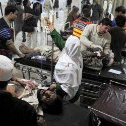 Wounded victims of a suicide bombing are treated at a hospital in Peshawar, Pakistan, in 2010 after a female suicide bomber detonated an explosives-laden vest in a crowded aid distribution center. Terrorist groups have been recruiting women for years, but authorities underestimate them, counterterrorism experts say. The Associated Press