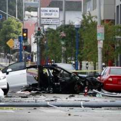 A street is closed after a car crash in West Hollywood, Calif., on July 4. The chances of dying in a crash in a late-model car or light truck fell by more than a third over three years. The Associated Press