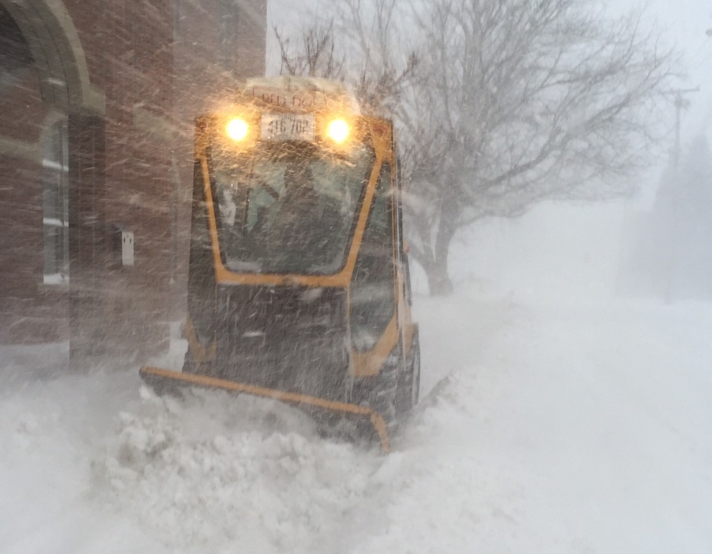 Kirk Lachance, an employee of he Waterville Public Works Department, plows a sidewalk in downtown Waterville on Tuesday morning.  Staff photo by Scott Monroe