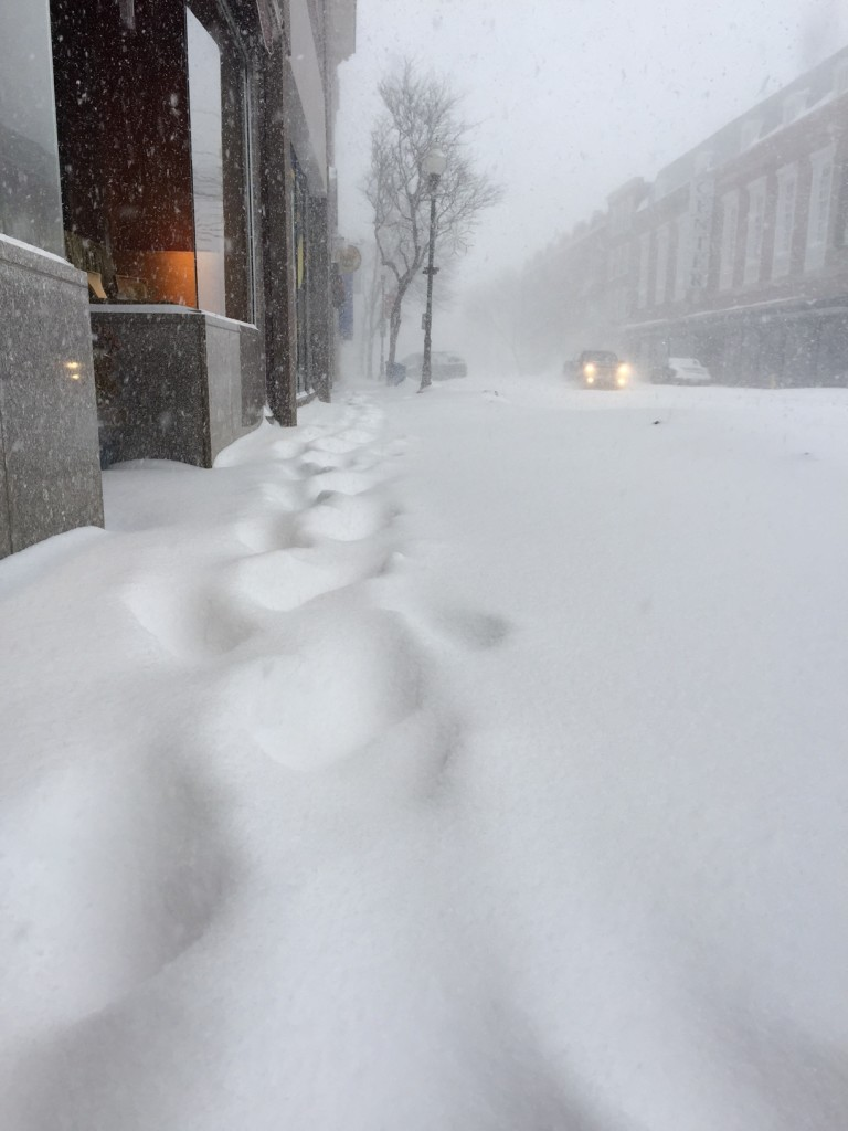 Barely visible bootprints on Main Street in downtown Waterville Tuesday as a snow storm engulfs central Maine.   Staff photo by Scott Monroe