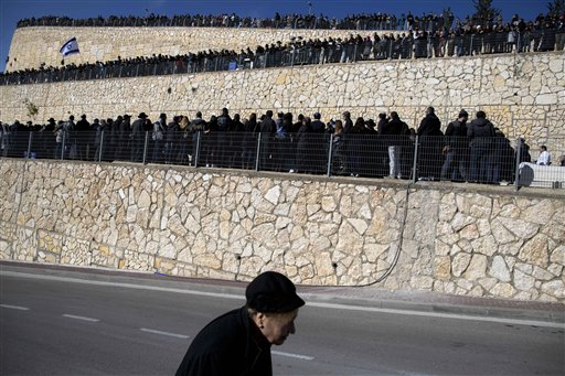 Family and relatives of four French Jewish victims of the attack on a kosher grocery store in Paris attend their funeral in Jerusalem. The Associated Press