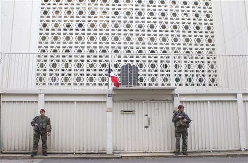 Soldiers stand guard outside a synagogue in Paris. France on Monday ordered 10,000 troops into the streets to protect sensitive sites. The Associated Press
