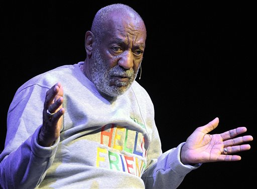 Bill Cosby performs during a Nov. 21, 2014, show in Melbourne, Fla., where he was greeted by an adoring audience that laughed so hard they slapped their knees, shouted love at the stage and rose to their feet as he came and went. Protesters didn't show and there were no hecklers. The Associated Press