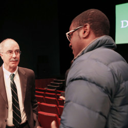 Dartmouth College President Philip Hanlon, left, speaks with a student after telling faculty and students about changes planned for the school Thursday in Hanover, N.H. Dartmouth College banned hard liquor on campus and said all students will have to take part in a sexual violence prevention program all four years they're enrolled at the Ivy League school. The Associated Press