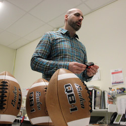 Baden Sports researcher director Hugh Tompkins shows footballs with different air pressures to be used in a demonstration, in Renton, Wash., on Thursday. Former Patriots quarterback Hugh Millen, who now helps design footballs for Baden, says quarterbacks prefer footballs with less air because of better grip and faster throws.  The Associated Press