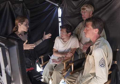 """Director Angelina Jolie speaks with actors Jack O'Connell, left, Domhnall Gleeson and Finn Witrock on the set of """"Unbroken."""" Universal Pictures photo"""