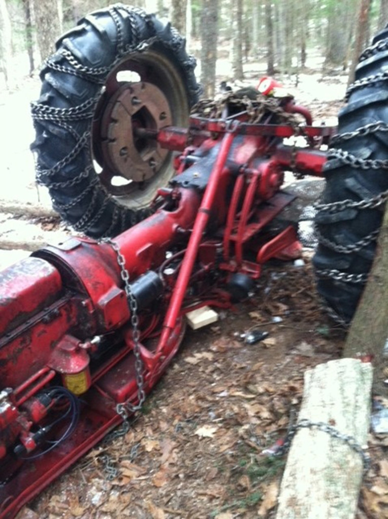 It took two hours to free a Greene man after he became trapped when this tractor overturned in Greene on Saturday. Courtesy Maine Department of Public Safety