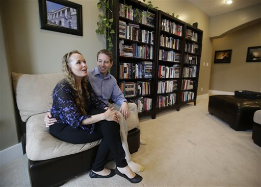 "Jeff Bennion and his wife Tanya sit in their home Monday. Jeff Bennion says he's happy with his wife and their 6-year-old son. ""I can't believe how lucky I am.""  The Associated Press"