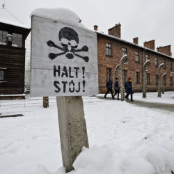 Visitors walk at the Auschwitz Nazi death camp in Oswiecim, Poland, Monday. The Associated Press