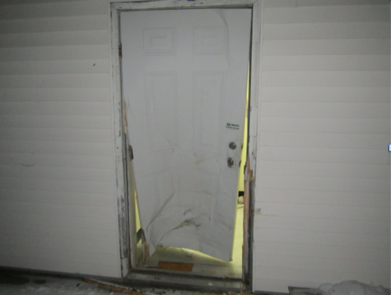 The rear door of the Mt. Blue Drug Store in Farmington shows damage allegedly caused by a man repeatedly ramming it with a pickup truck. Courtesy Farmington Police Department