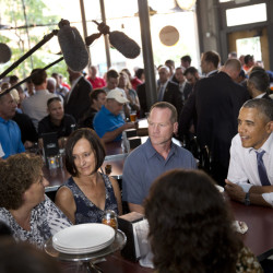 Leslie Gresham, left, Carolyn Reed and David Johnson, all of whom wrote President Barack Obama letters, have dinner with the President in Denver on July 8, 2014. Reed is a guest to watch President Barack Obama's State of the Union address on Capitol Hill Tuesday. The Associated Press