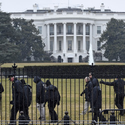 Secret Service officers search the south grounds of the White House Monday, after a 20-foot 'quad copter' drone was found on the grounds during the middle of the night. The Associated Press
