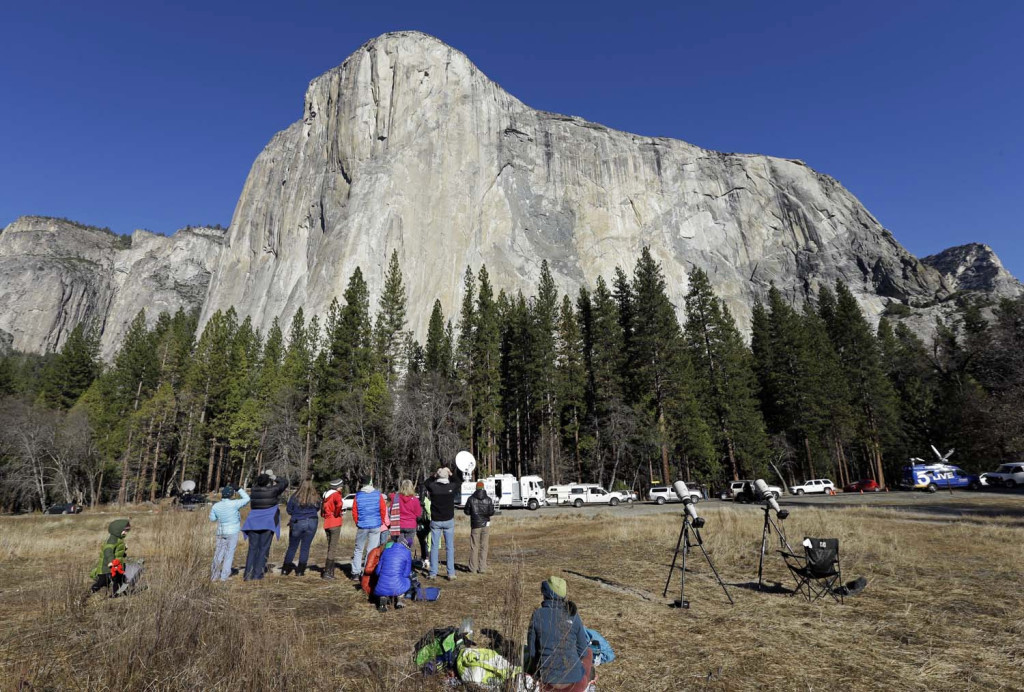Spectators on the valley floor in Yosemite National Park, Calif. gaze at El Capitan for a glimpse of climbers Tommy Caldwell and Kevin Jorgeson on Wednesday. The Associated Press