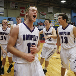 FEB 28 FINALS: Jake Black of Hampden Academy joins his teammates on the floor as they celebrate their victory over Portland in the Class A State Championship. Derek Davis/Staff Photographer