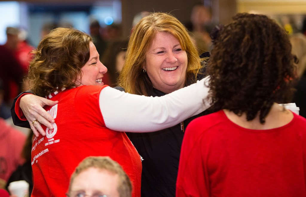 FairPoint striking employees Renee Dugas, left, and Erin Thibodeau embrace before a meeting to vote on a settlement at the Fireside Inn in Portland.