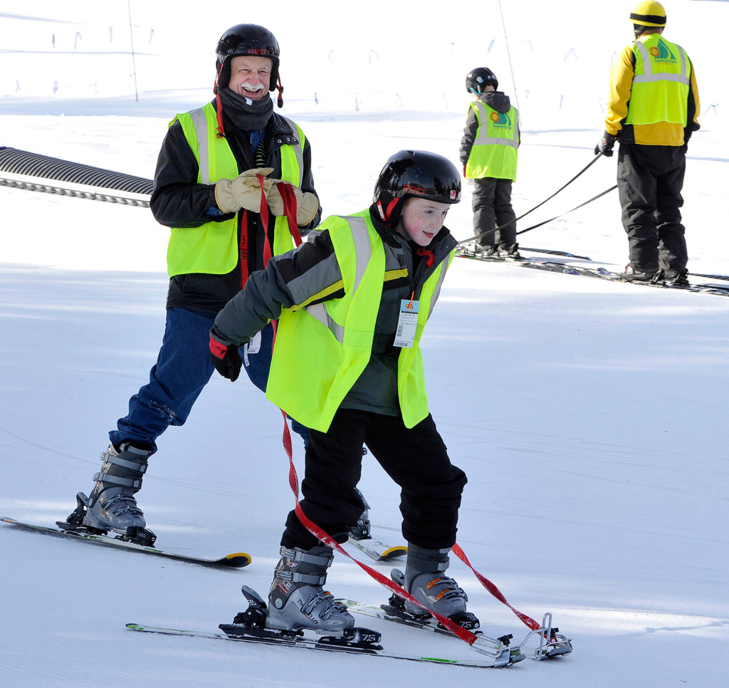 Autistic boy with steep hill to climb conquers the slopes