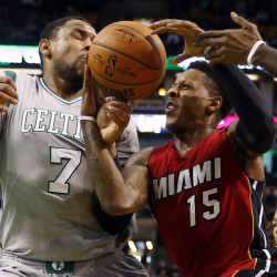 Miami Heat's Mario Chalmers, 15, tries to hold onto the ball while getting by Boston Celtics' Jared Sullinger in the first half Sunday in Boston.