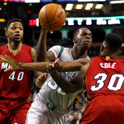 Boston's Brandon Bass is caught between Miami's Udonis Haslem (40) and Norris Cole (30) during the second half of the Miami Heat's 83-75 win Sunday in Boston.