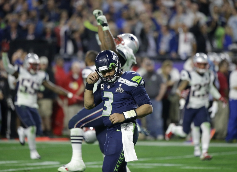 Seattle Seahawks quarterback Russell Wilson (3) reacts after throwing an interception to New England Patriots strong safety Malcolm Butler during the second half of Super Bowl XLIX on Sunday in Glendale, Ariz. The Patriots won 28-24.