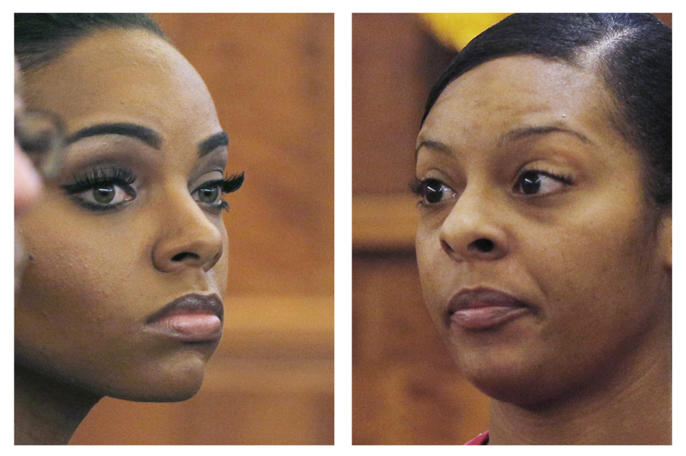 Shayanna Jenkins, left, fiancee of former  NFL football player Aaron Hernandez, listens to her sister Shaneah Jenkins, right, testify during Hernandez's murder trial at Bristol County Superior Court in Fall River, Mass. Hernandez is accused of the June 2013 killing of Odin Lloyd.