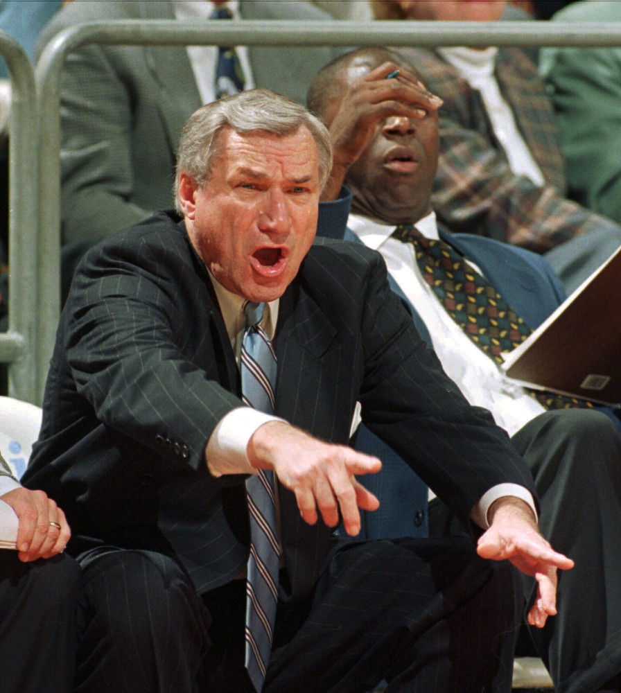 """North Carolina head coach Dean Smith yells at his players during ACC basketball action against Florida State in 1997 in Tallahassee, Fla. Smith, the North Carolina basketball coaching great who won two national championships, died """"peacefully"""" at his home Saturday night the school said in a statement Sunday from Smith's family. He was 83."""