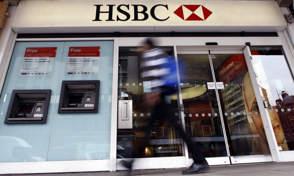 In this Feb. 27, 2012 file photo, a pedestrian passes a branch of HSBC bank in London. The chair of parliaments Public Accounts Committee says the former chief of HSBC must face serious questions after once-secret papers outlined how the bank helped the wealthy dodge taxes.