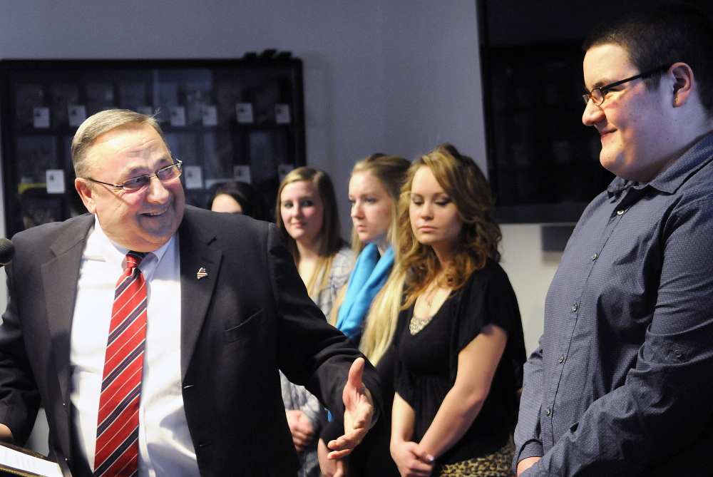Gov. Paul LePage acknowledges Jobs for Maine's Graduates students and others during an announcement Tuesday at the State House of a $200,000 grant from AT&T to expand the program to Augusta's Cony High School.