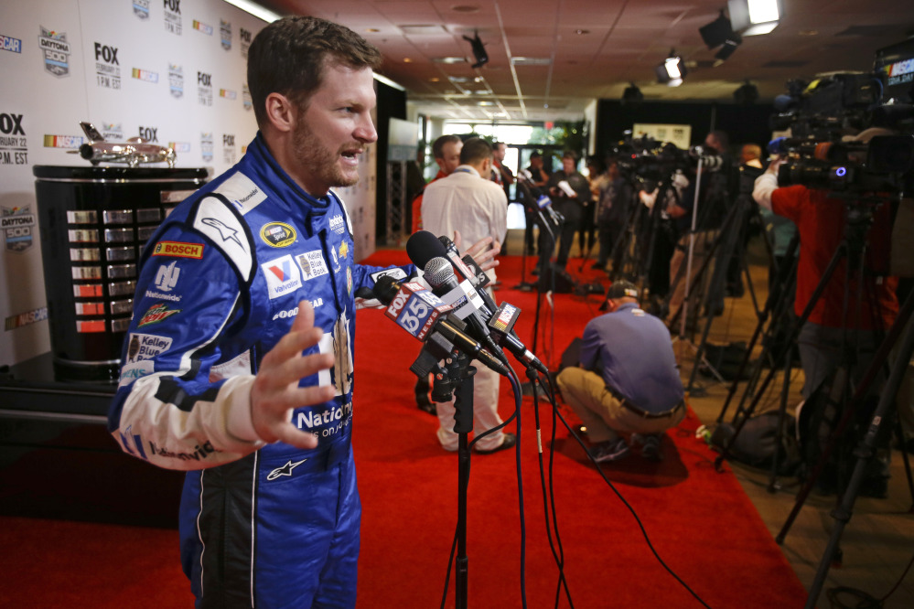 Dale Earnhardt Jr. talks with reporters Thursday during NASCAR media day at Daytona International Speedway in Daytona Beach, Fla.
