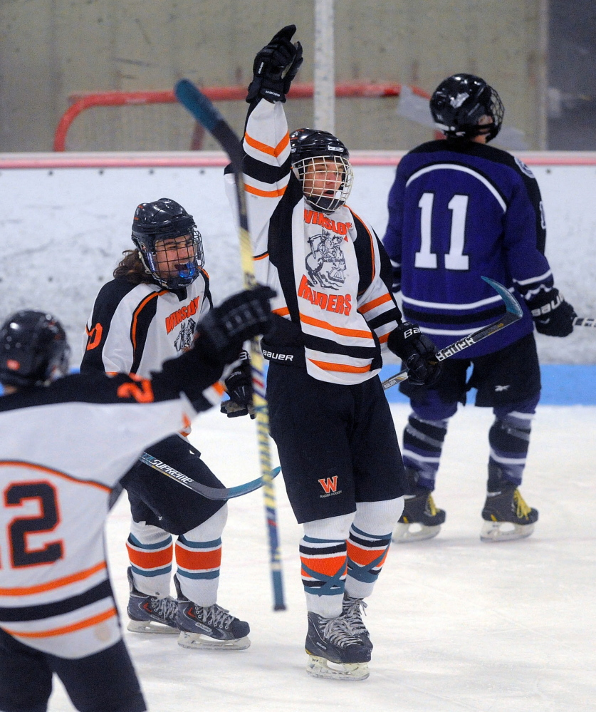 Winslow High School's Jimmy Fowler points to the sky after scoring a goal Wednesday against Waterville in the first period at Sukee Arena in Winslow. Fowler's mother passed away Tuesday morning after a lengthy battle with cancer.
