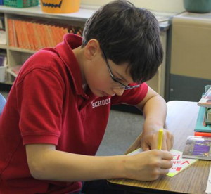 Contributed photo   Michael Flannery, a fifth-grade student at St. Michael School in Augusta, creates a greeting card.
