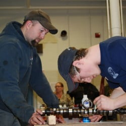 Tyler Pooler, right, a Winslow High School student, competes in one of the automotive competitions, while being judged by Craig Smiley.