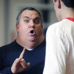 Cony boys basketball coach T.J. Maines addresses his team during a timeout in a game against Edward Little on Feb. 3. The Rams had their Eastern A quarterfinal against Lewiston pushed from Saturday to Monday because of the latest winter storm.