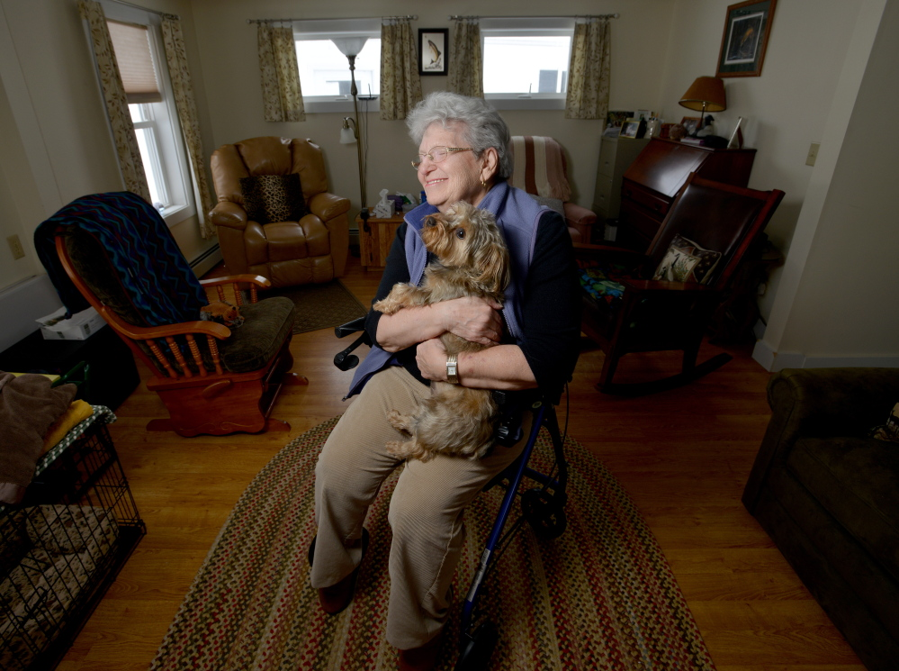 Dot Titicomb pwith her dog Molly at her home in Chesterville on Thursday. Titcomb is visited weekly as part of the Franklin County Sheriff's Departmentn Elder Check program.