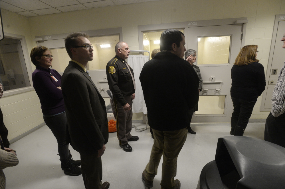 Legislators and county officials take a tour of the Cumberland County Jail's infirmary on Jan. 26, 2015.