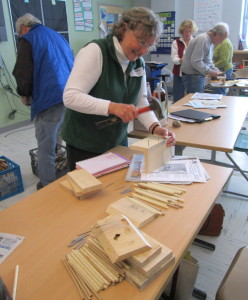 Linda Redman, of Boothbay, makes a pollinator nest box at last year's Rural Living Day.