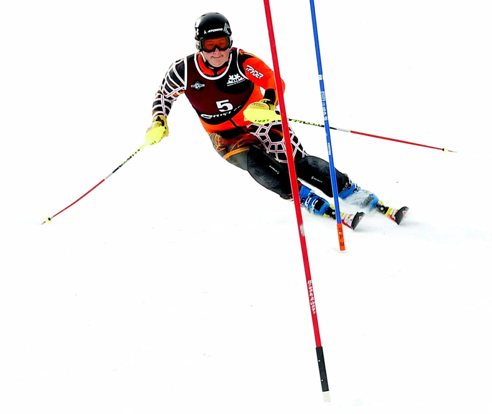 Kyle Farrington of Mt. Blue High School makes his way to the finish line during slalom races Tuesday at Mt. Abram in Greenwood.