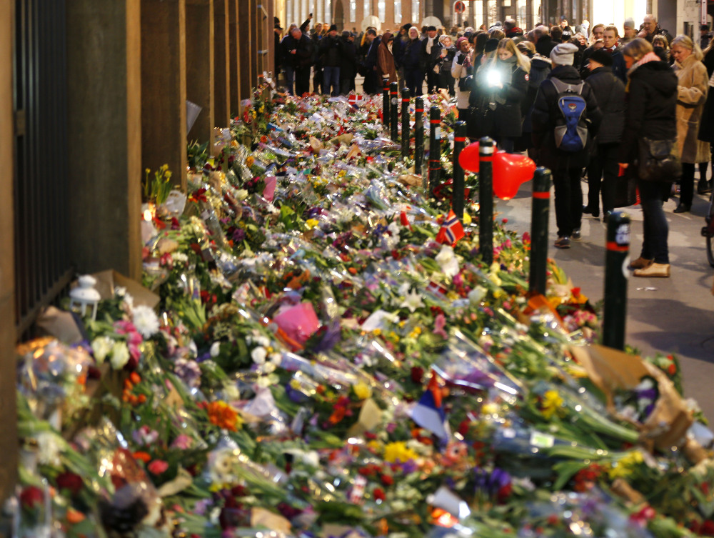 Flowers are laid in front of the synagogue in Copenhagen, Denmark, Tuesday, Feb. 17, 2015.