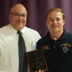 Chief Ted Blais, left, presents and Officer Dave Daigneault with the Officer of the Year Award.