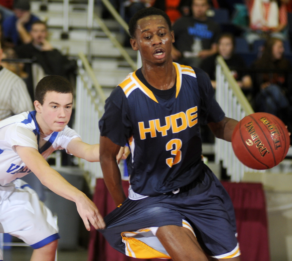 Valley High School's Nathan Ames draws a foul on Hyde School's Antoine Montgomery during the final minutes of a Western Class D semifinal game in Augusta Wednesday.